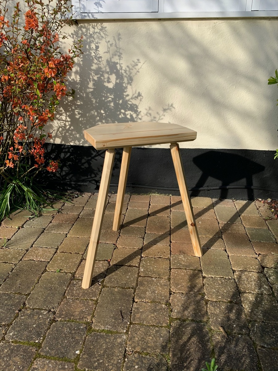 pegged-mortise-stool-outside-with-flowers